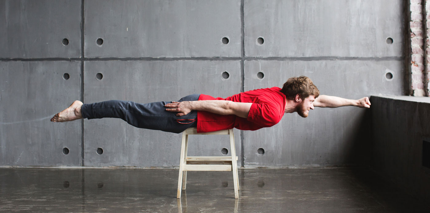 Man planking in superman pose